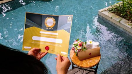 person holding gift voucher over pool